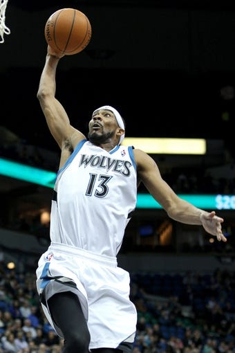Mar 26, 2014; Minneapolis, MN, USA; Minnesota Timberwolves forward Corey Brewer (13) dunks during the third quarter against the Atlanta Hawks at Target Center. The Timberwolves defeated the Hawks 107-83. Mandatory Credit: Brace Hemmelgarn-USA TODAY Sports