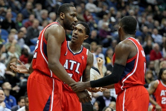 Mar 26, 2014; Minneapolis, MN, USA; Atlanta Hawks guard Louis Williams (3) talks with forward Elton Brand (42) during the third quarter against the Minnesota Timberwolves at Target Center. The Timberwolves defeated the Hawks 107-83. Mandatory Credit: Brace Hemmelgarn-USA TODAY Sports