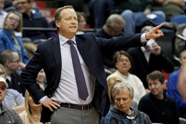 Mar 26, 2014; Minneapolis, MN, USA; Atlanta Hawks head coach Mike Budenholzer calls a play during the first quarter against the Minnesota Timberwolves at Target Center. The Timberwolves defeated the Hawks 107-83. Mandatory Credit: Brace Hemmelgarn-USA TODAY Sports