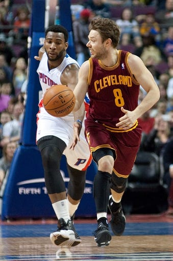 Mar 26, 2014; Auburn Hills, MI, USA; Detroit Pistons center Andre Drummond (0) attempts to steal the ball from Cleveland Cavaliers guard Matthew Dellavedova (8) during the third quarter at The Palace of Auburn Hills. Cleveland won 97-96. Mandatory Credit: Tim Fuller-USA TODAY Sports