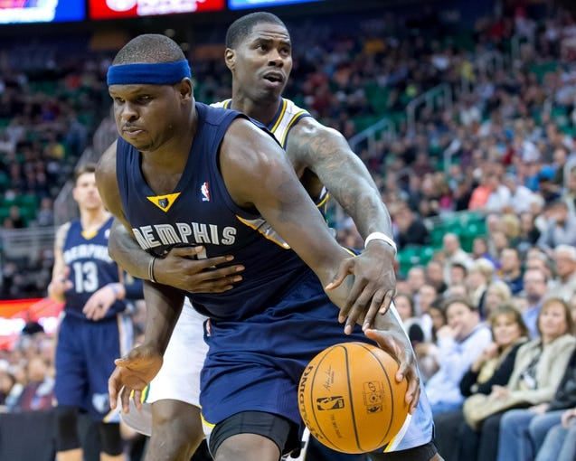 Mar 26, 2014; Salt Lake City, UT, USA; Utah Jazz forward Marvin Williams (2) fouls Memphis Grizzlies forward Zach Randolph (50) during the second half at EnergySolutions Arena. The Grizzlies won 91-87. Mandatory Credit: Russ Isabella-USA TODAY Sports