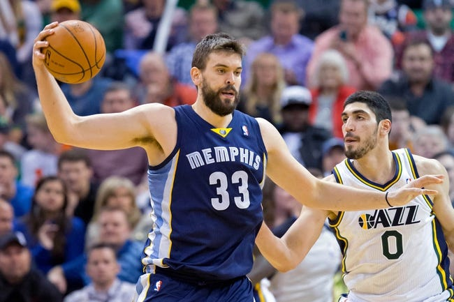 Mar 26, 2014; Salt Lake City, UT, USA; Utah Jazz center Enes Kanter (0) defends against Memphis Grizzlies center Marc Gasol (33) during the second half at EnergySolutions Arena. The Grizzlies won 91-87. Mandatory Credit: Russ Isabella-USA TODAY Sports