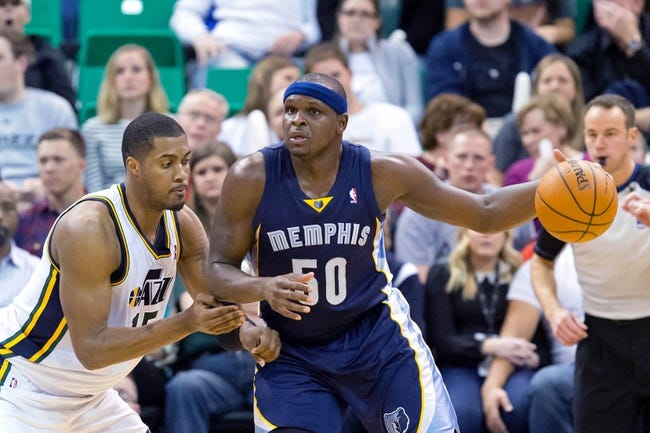 Mar 26, 2014; Salt Lake City, UT, USA; Utah Jazz center Derrick Favors (15) defends against Memphis Grizzlies forward Zach Randolph (50) during the second half at EnergySolutions Arena. The Grizzlies won 91-87. Mandatory Credit: Russ Isabella-USA TODAY Sports