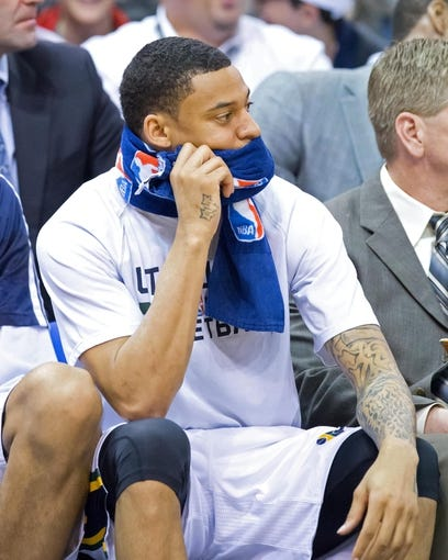 Mar 26, 2014; Salt Lake City, UT, USA; Utah Jazz guard Diante Garrett (8) watches the action from the bench during the second half against the Memphis Grizzlies at EnergySolutions Arena. The Grizzlies won 91-87. Mandatory Credit: Russ Isabella-USA TODAY Sports