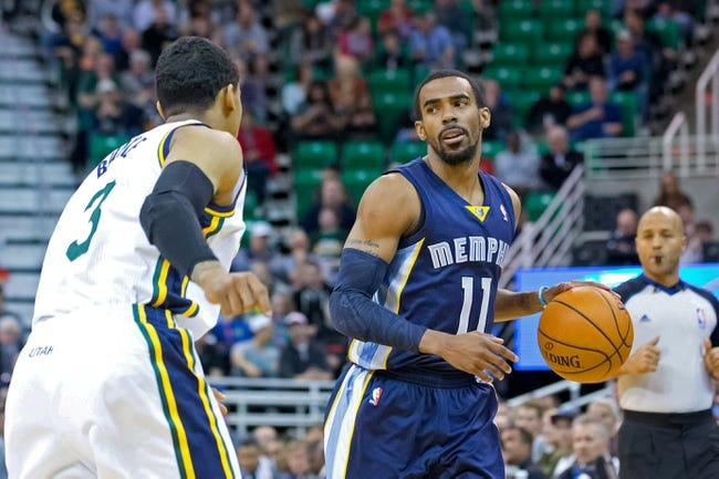 Mar 26, 2014; Salt Lake City, UT, USA; Utah Jazz guard Trey Burke (3) defends against Memphis Grizzlies guard Mike Conley (11) during the first half at EnergySolutions Arena. The Grizzlies won 91-87. Mandatory Credit: Russ Isabella-USA TODAY Sports