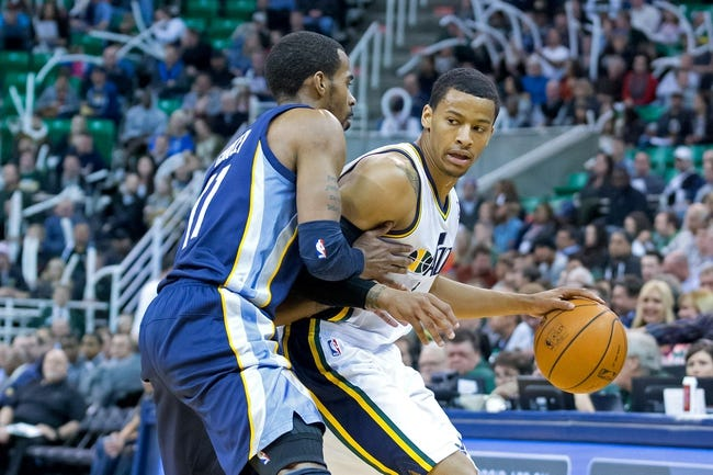 Mar 26, 2014; Salt Lake City, UT, USA; Memphis Grizzlies guard Mike Conley (11) defends against Utah Jazz guard Trey Burke (3) during the second half at EnergySolutions Arena. The Grizzlies won 91-87. Mandatory Credit: Russ Isabella-USA TODAY Sports