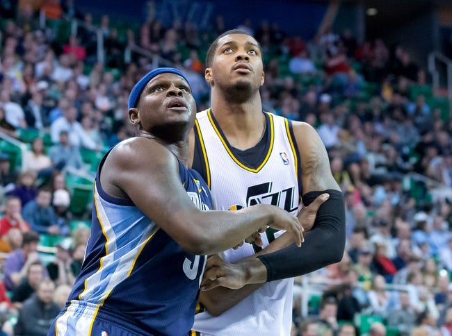 Mar 26, 2014; Salt Lake City, UT, USA; Memphis Grizzlies forward Zach Randolph (50) boxes out Utah Jazz center Derrick Favors (15) during the second half at EnergySolutions Arena. The Grizzlies won 91-87. Mandatory Credit: Russ Isabella-USA TODAY Sports