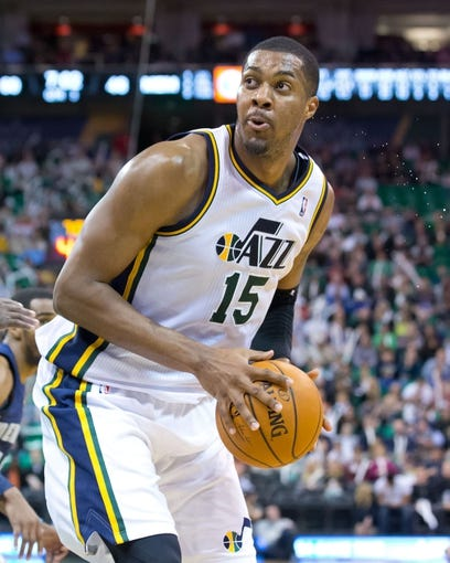 Mar 26, 2014; Salt Lake City, UT, USA; Utah Jazz center Derrick Favors (15) controls the ball during the second half against the Memphis Grizzlies at EnergySolutions Arena. The Grizzlies won 91-87. Mandatory Credit: Russ Isabella-USA TODAY Sports