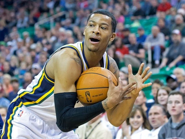 Mar 26, 2014; Salt Lake City, UT, USA; Utah Jazz guard Trey Burke (3) calls a timeout during the second half against the Memphis Grizzlies at EnergySolutions Arena. The Grizzlies won 91-87. Mandatory Credit: Russ Isabella-USA TODAY Sports