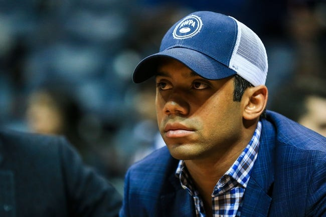 Mar 27, 2014; Atlanta, GA, USA; Seattle Seahawks quarterback Russell Wilson sits court side in the first half between the Portland Trail Blazers and the Atlanta Hawks at Philips Arena. Mandatory Credit: Daniel Shirey-USA TODAY Sports