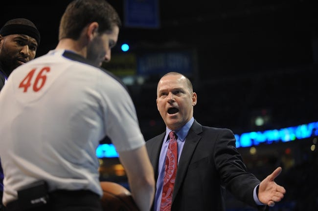 Mar 28, 2014; Oklahoma City, OK, USA; Sacramento Kings head coach Michael Malone discusses a call with NBA Official Ben Taylor in a break in action against the Oklahoma City Thunder at Chesapeake Energy Arena. Mandatory Credit: Mark D. Smith-USA TODAY Sports