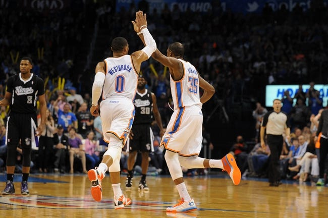 Mar 28, 2014; Oklahoma City, OK, USA; Oklahoma City Thunder guard Russell Westbrook (0) and Oklahoma City Thunder forward Kevin Durant (35) celebrate after a play against the Sacramento Kings during the third quarter at Chesapeake Energy Arena. Mandatory Credit: Mark D. Smith-USA TODAY Sports