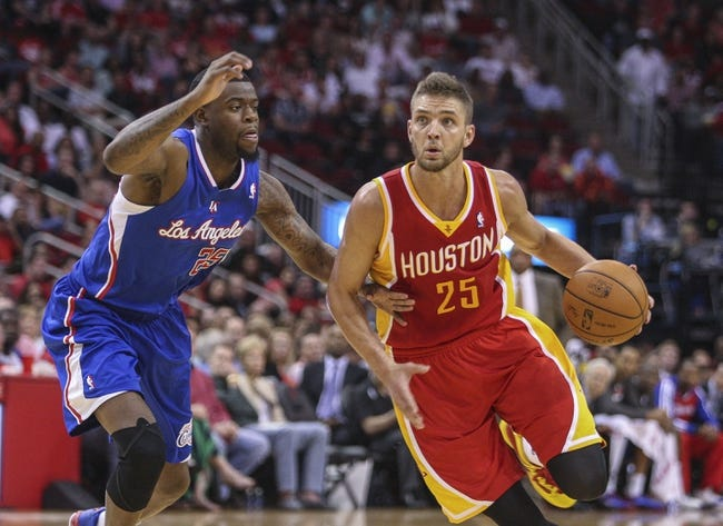 Mar 29, 2014; Houston, TX, USA; Houston Rockets forward Chandler Parsons (25) drives to the basket during the second quarter as Los Angeles Clippers guard Reggie Bullock (25) defends at Toyota Center. Mandatory Credit: Troy Taormina-USA TODAY Sports