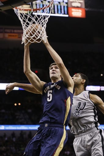 Mar 29, 2014; San Antonio, TX, USA; New Orleans Pelicans center Jeff Withey (5) shoots the ball past San Antonio Spurs forward Tim Duncan (21) during the first half at AT&T Center. Mandatory Credit: Soobum Im-USA TODAY Sports