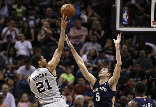 Mar 29, 2014; San Antonio, TX, USA; San Antonio Spurs forward Tim Duncan (21) shoots the ball over New Orleans Pelicans center Jeff Withey (5) during the first half at AT&T Center. Mandatory Credit: Soobum Im-USA TODAY Sports