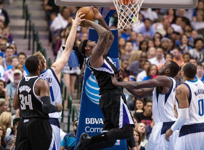Mar 29, 2014; Dallas, TX, USA; Dallas Mavericks forward Dirk Nowitzki (41) blocks a shot by Sacramento Kings center DeMarcus Cousins (15) during the first half at the American Airlines Center. Mandatory Credit: Jerome Miron-USA TODAY Sports