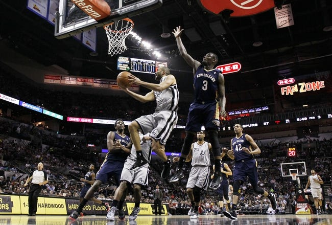 Mar 29, 2014; San Antonio, TX, USA; San Antonio Spurs guard Tony Parker (9) drives to the basket past New Orleans Pelicans guard Anthony Morrow (3) during the second half at AT&T Center. Mandatory Credit: Soobum Im-USA TODAY Sports