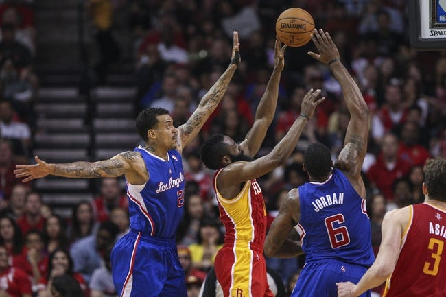 Mar 29, 2014; Houston, TX, USA; Houston Rockets guard James Harden (13) shoots during the third quarter as Los Angeles Clippers center DeAndre Jordan (6) defends at Toyota Center. The Clippers defeated the Rockets 118-107. Mandatory Credit: Troy Taormina-USA TODAY Sports