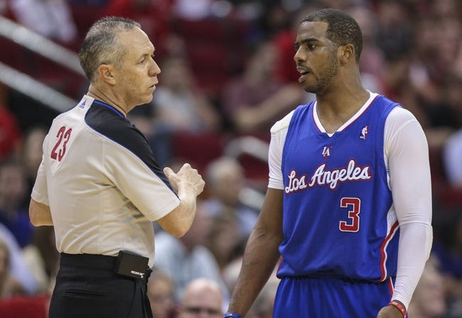 Mar 29, 2014; Houston, TX, USA; Los Angeles Clippers guard Chris Paul (3) talks to referee Jason Phillips (23) during the fourth quarter against the Houston Rockets at Toyota Center. The Clippers defeated the Rockets 118-107. Mandatory Credit: Troy Taormina-USA TODAY Sports