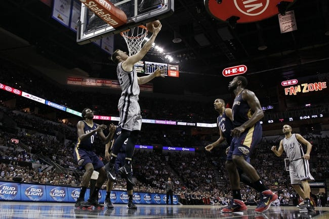 Mar 29, 2014; San Antonio, TX, USA; San Antonio Spurs forward Aron Baynes (16) shoots the ball against the New Orleans Pelicans during the second half at AT&T Center. Mandatory Credit: Soobum Im-USA TODAY Sports
