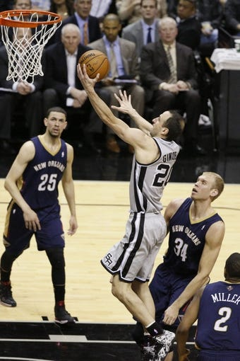 Mar 29, 2014; San Antonio, TX, USA; San Antonio Spurs guard Manu Ginobili (20) shoots the ball as New Orleans Pelicans center Greg Stiemsma (34) looks on during the second half at AT&T Center. The Spurs won 96-80. Mandatory Credit: Soobum Im-USA TODAY Sports