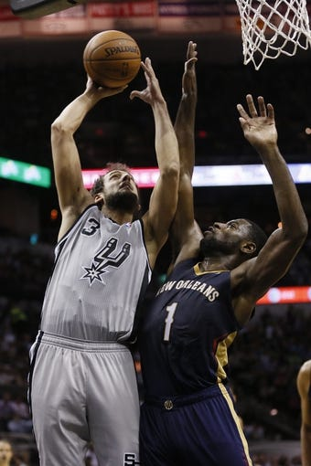 Mar 29, 2014; San Antonio, TX, USA; San Antonio Spurs forward Marco Belinelli (3) shoots the ball as New Orleans Pelicans forward Tyreke Evans (1) defends during the second half at AT&T Center. The Spurs won 96-80. Mandatory Credit: Soobum Im-USA TODAY Sports