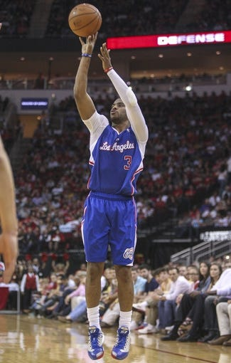 Mar 29, 2014; Houston, TX, USA; Los Angeles Clippers guard Chris Paul (3) shoots during the fourth quarter against the Houston Rockets at Toyota Center. The Clippers defeated the Rockets 118-107. Mandatory Credit: Troy Taormina-USA TODAY Sports