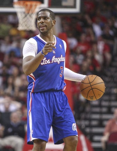 Mar 29, 2014; Houston, TX, USA; Los Angeles Clippers guard Chris Paul (3) brings the ball up the court during the fourth quarter against the Houston Rockets at Toyota Center. The Clippers defeated the Rockets 118-107. Mandatory Credit: Troy Taormina-USA TODAY Sports