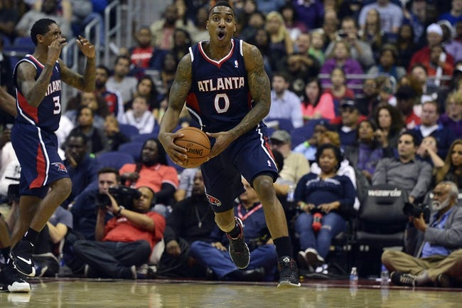 Mar 29, 2014; Washington, DC, USA; Atlanta Hawks guard Jeff Teague (0) reacts after being assessed a foul during the fourth quarter of the game against Washington Wizards  at Verizon Center. Washington Wizards defeated Atlanta Hawks 101-97. Mandatory Credit: Tommy Gilligan-USA TODAY Sports