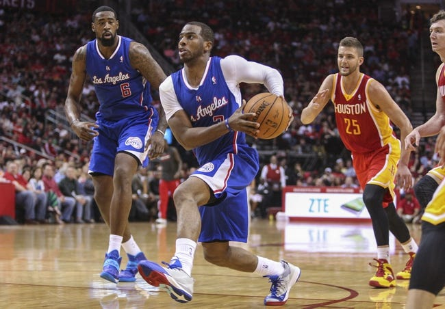 Mar 29, 2014; Houston, TX, USA; Los Angeles Clippers guard Chris Paul (3) drives the ball during the third quarter against the Houston Rockets at Toyota Center. The Clippers defeated the Rockets 118-107. Mandatory Credit: Troy Taormina-USA TODAY Sports