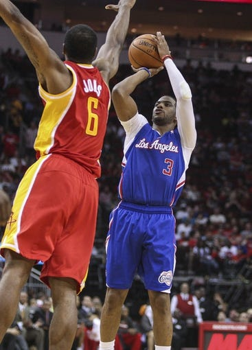 Mar 29, 2014; Houston, TX, USA; Los Angeles Clippers guard Chris Paul (3) shoots during the third quarter against the Houston Rockets at Toyota Center. Mandatory Credit: Troy Taormina-USA TODAY Sports