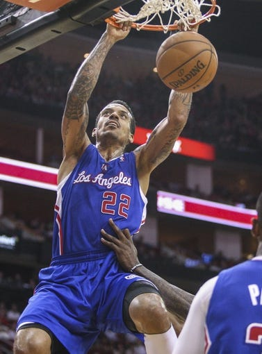 Mar 29, 2014; Houston, TX, USA; Los Angeles Clippers forward Matt Barnes (22) dunks the ball during the third quarter against the Houston Rockets at Toyota Center. The Clippers defeated the Rockets 118-107. Mandatory Credit: Troy Taormina-USA TODAY Sports