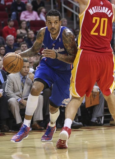 Mar 29, 2014; Houston, TX, USA; Los Angeles Clippers forward Matt Barnes (22) drives the ball during the fourth quarter against the Houston Rockets at Toyota Center. The Clippers defeated the Rockets 118-107. Mandatory Credit: Troy Taormina-USA TODAY Sports
