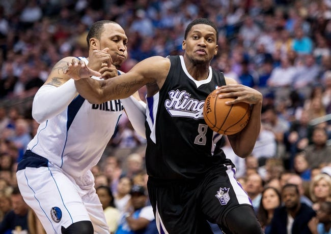 Mar 29, 2014; Dallas, TX, USA; Sacramento Kings forward Rudy Gay (8) drives to the basket past Dallas Mavericks forward Shawn Marion (0) during the second half at the American Airlines Center. Gay leads his team with 30 points. The Mavericks defeated the Kings 103-100. Mandatory Credit: Jerome Miron-USA TODAY Sports