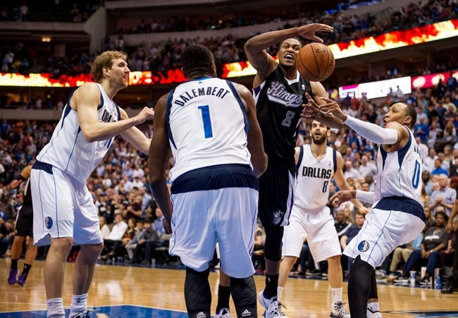 Mar 29, 2014; Dallas, TX, USA; Dallas Mavericks forward Dirk Nowitzki (41) and center Samuel Dalembert (1) and guard Jose Calderon (8) and forward Shawn Marion (0) defend against Sacramento Kings forward Rudy Gay (8) during the second half at the American Airlines Center. Gay leads his team with 30 points. The Mavericks defeated the Kings 103-100. Mandatory Credit: Jerome Miron-USA TODAY Sports