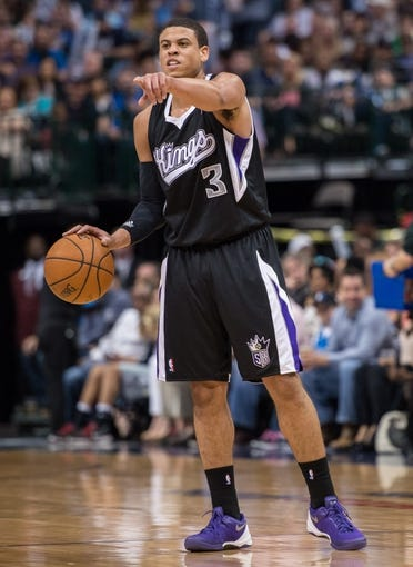 Mar 29, 2014; Dallas, TX, USA; Sacramento Kings guard Ray McCallum (3) sets the play against the Dallas Mavericks during the second half at the American Airlines Center. The Mavericks defeated the Kings 103-100. Mandatory Credit: Jerome Miron-USA TODAY Sports