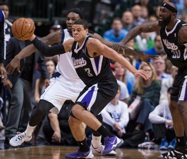 Mar 29, 2014; Dallas, TX, USA; Sacramento Kings guard Ray McCallum (3) steals the ball from Dallas Mavericks forward Jae Crowder (9) during the second half at the American Airlines Center. The Mavericks defeated the Kings 103-100. Mandatory Credit: Jerome Miron-USA TODAY Sports