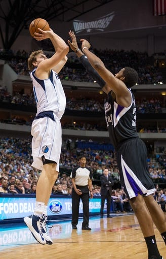 Mar 29, 2014; Dallas, TX, USA; Dallas Mavericks forward Dirk Nowitzki (41) shoots over Sacramento Kings forward Jason Thompson (34) during the first half at the American Airlines Center. Nowitzki leads his team with 19 points. The Mavericks defeated the Kings 103-100. Mandatory Credit: Jerome Miron-USA TODAY Sports