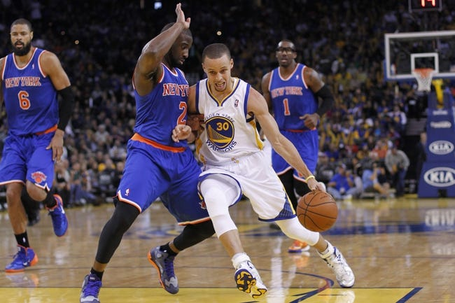 Mar 30, 2014; Oakland, CA, USA; Golden State Warriors guard Stephen Curry (30) dribbles the ball around New York Knicks guard Raymond Felton (2) in the third quarter at Oracle Arena. The Knicks won 89-84. Mandatory Credit: Cary Edmondson-USA TODAY Sports