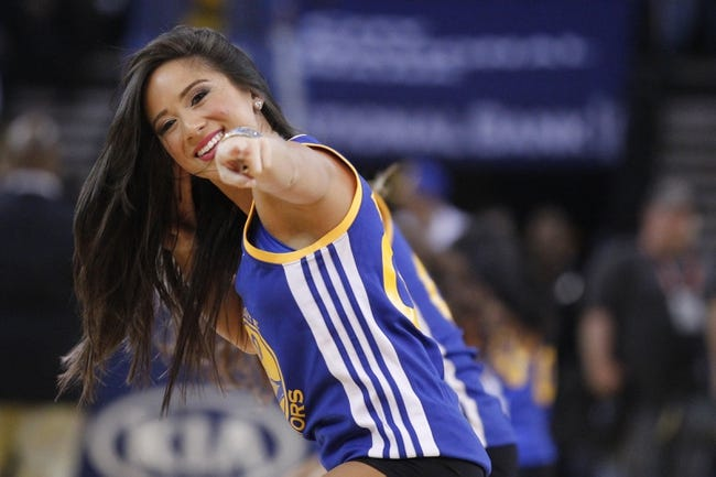 Mar 30, 2014; Oakland, CA, USA; A Golden State Warriors cheerleader dances during a timeout against the New York Knicks in the first quarter at Oracle Arena. The Knicks won 89-84. Mandatory Credit: Cary Edmondson-USA TODAY Sports