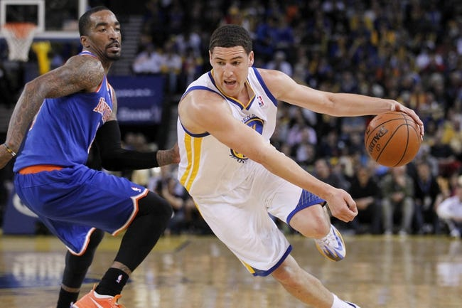 Mar 30, 2014; Oakland, CA, USA; Golden State Warriors guard Klay Thompson (11) dribbles the ball past New York Knicks guard J.R. Smith (8) in the third quarter at Oracle Arena. The Knicks won 89-84. Mandatory Credit: Cary Edmondson-USA TODAY Sports