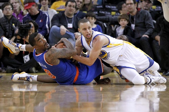 Mar 30, 2014; Oakland, CA, USA; New York Knicks guard J.R. Smith (8) battles for the ball with Golden State Warriors guard Stephen Curry (30) in the third quarter at Oracle Arena. The Knicks won 89-84. Mandatory Credit: Cary Edmondson-USA TODAY Sports
