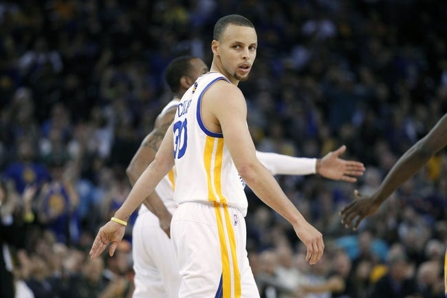 Mar 30, 2014; Oakland, CA, USA; Golden State Warriors guard Stephen Curry (30) reacts after scoring against the New York Knicks in the fourth quarter at Oracle Arena. The Knicks won 89-84. Mandatory Credit: Cary Edmondson-USA TODAY Sports