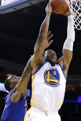Mar 30, 2014; Oakland, CA, USA; Golden State Warriors forward Andre Iguodala (9) is fouled by New York Knicks guard J.R. Smith (8) in the fourth quarter at Oracle Arena. The Knicks won 89-84. Mandatory Credit: Cary Edmondson-USA TODAY Sports