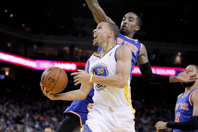 Mar 30, 2014; Oakland, CA, USA; Golden State Warriors guard Stephen Curry (30) shoots the ball as New York Knicks guard J.R. Smith (8) defends in the fourth quarter at Oracle Arena. The Knicks won 89-84. Mandatory Credit: Cary Edmondson-USA TODAY Sports