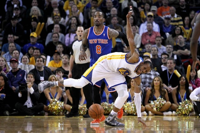 Mar 30, 2014; Oakland, CA, USA; Golden State Warriors forward Andre Iguodala (9) loses control of the ball in front of New York Knicks guard J.R. Smith (8) in the fourth quarter at Oracle Arena. The Knicks won 89-84. Mandatory Credit: Cary Edmondson-USA TODAY Sports