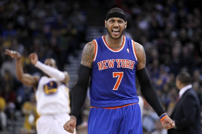 Mar 30, 2014; Oakland, CA, USA; New York Knicks forward Carmelo Anthony (7) reacts on the court against the Golden State Warriors in the fourth quarter at Oracle Arena. The Knicks won 89-84. Mandatory Credit: Cary Edmondson-USA TODAY Sports