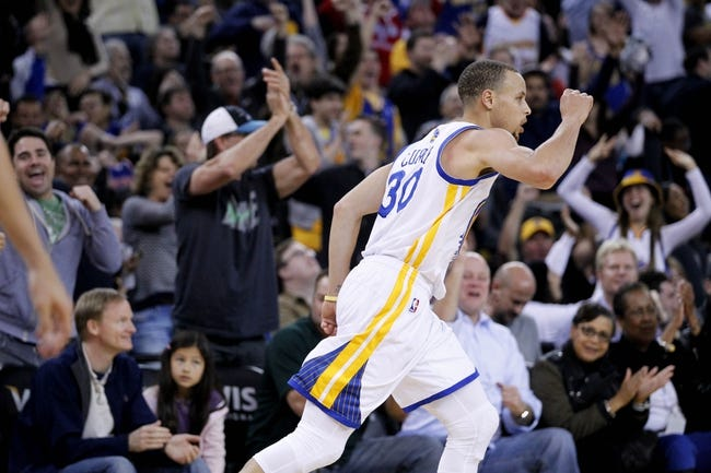 Mar 30, 2014; Oakland, CA, USA; Golden State Warriors guard Stephen Curry (30) celebrates after scoring against the New York Knicks in the fourth quarter at Oracle Arena. The Knicks won 89-84. Mandatory Credit: Cary Edmondson-USA TODAY Sports