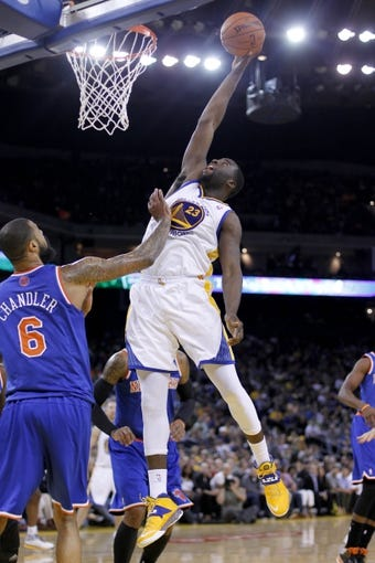 Mar 30, 2014; Oakland, CA, USA; Golden State Warriors forward Draymond Green (23) shoots the ball over New York Knicks center Tyson Chandler (6) in the third quarter at Oracle Arena. The Knicks won 89-84. Mandatory Credit: Cary Edmondson-USA TODAY Sports