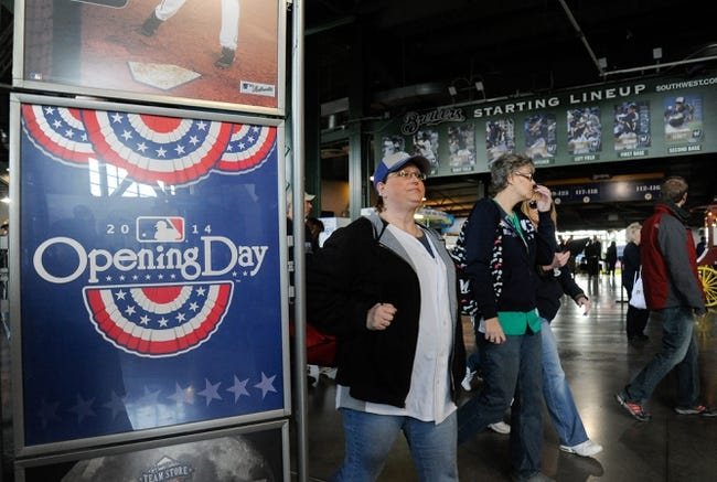 Mar 31, 2014; Milwaukee, WI, USA;   Fans arrive for the opening day of baseball game between the Milwaukee Brewers and Atlanta Braves at Miller Park. Mandatory Credit: Benny Sieu-USA TODAY Sports